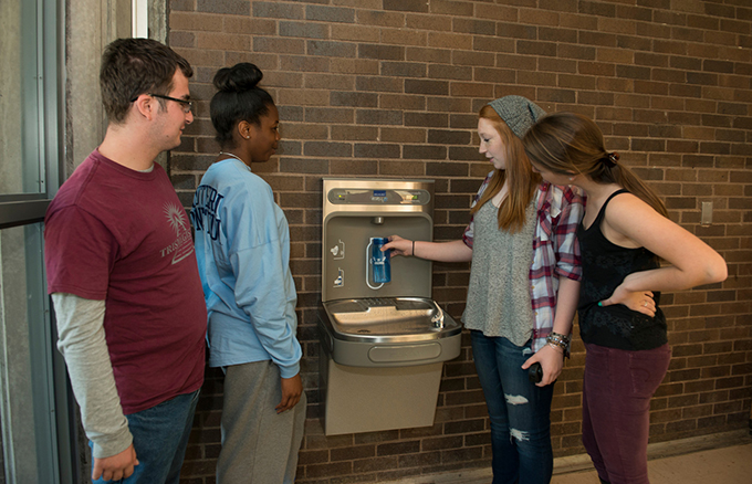 Students use one of the Southern campus' water bottle refilling stations.