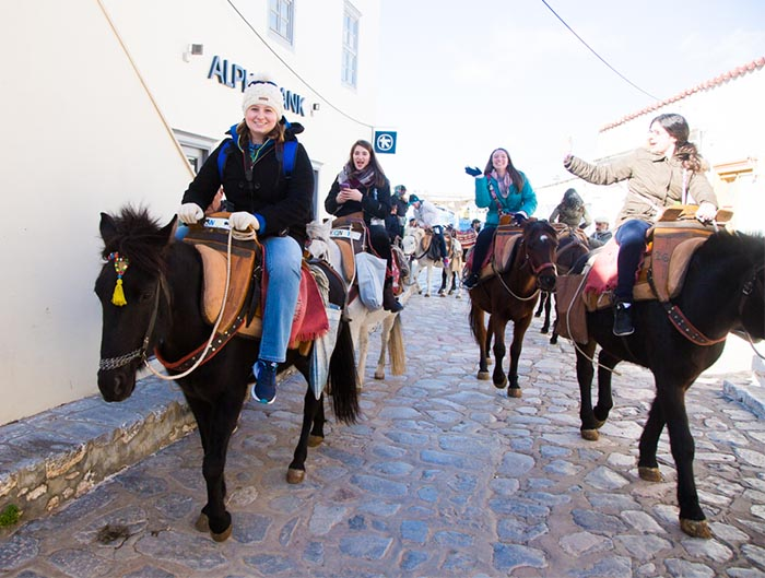 Riding donkeys on Hydra, Greece