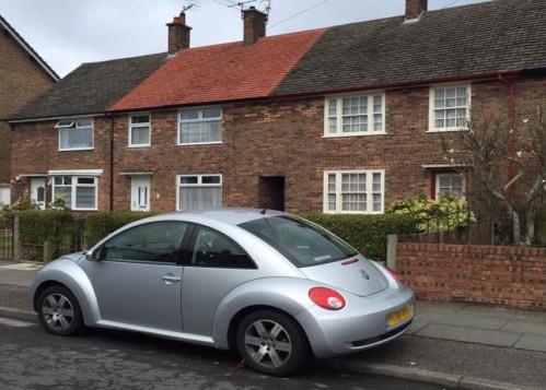 Volkswagen Beatle parked outside of the boyhood home of John Lennon
