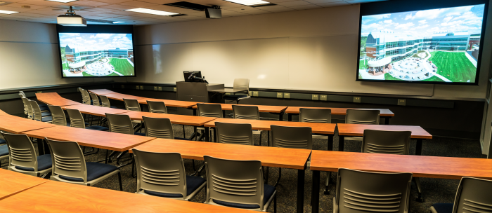 classroom with podium and projectors