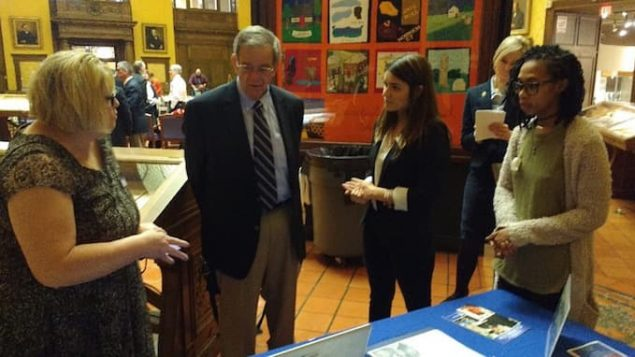 State Historian Walter W. Woodward, second from left, and Emily E. Hein, director of Communications for the Connecticut Department of Veterans' Affairs, discuss the research projects of