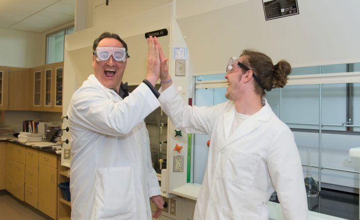 Assistant Professor James Kearns in chemstry lab with chemistry major Cody Edson