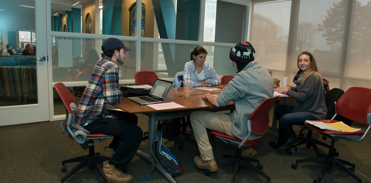 students collaborating in private study room; SCSU Hilton C. Buley Library