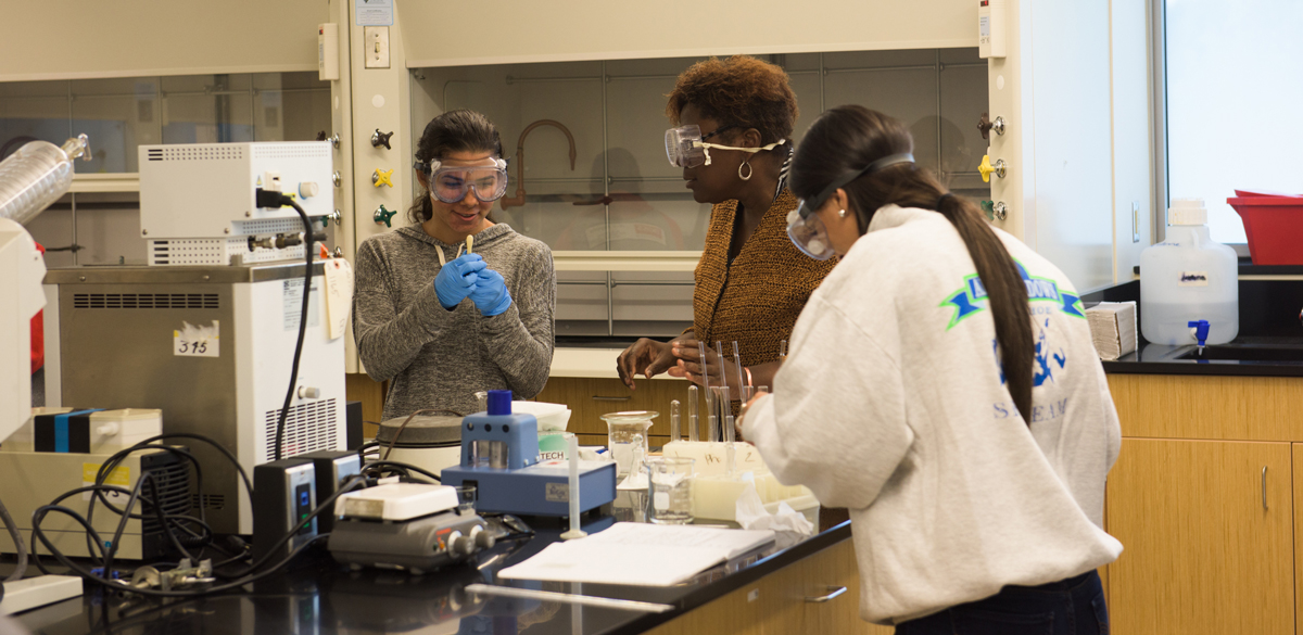 professor and students in lab; SCSU Academic Science and Laboratory building