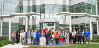 Presenters and attendees of the Material Science and Manufacturing in front of SCSU's science building