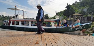 Dr. William Faraclas and his students prepare to cross Lake Atitlán to visit a comadrona—a traditional birth attendant—in San Juan La Laguna.