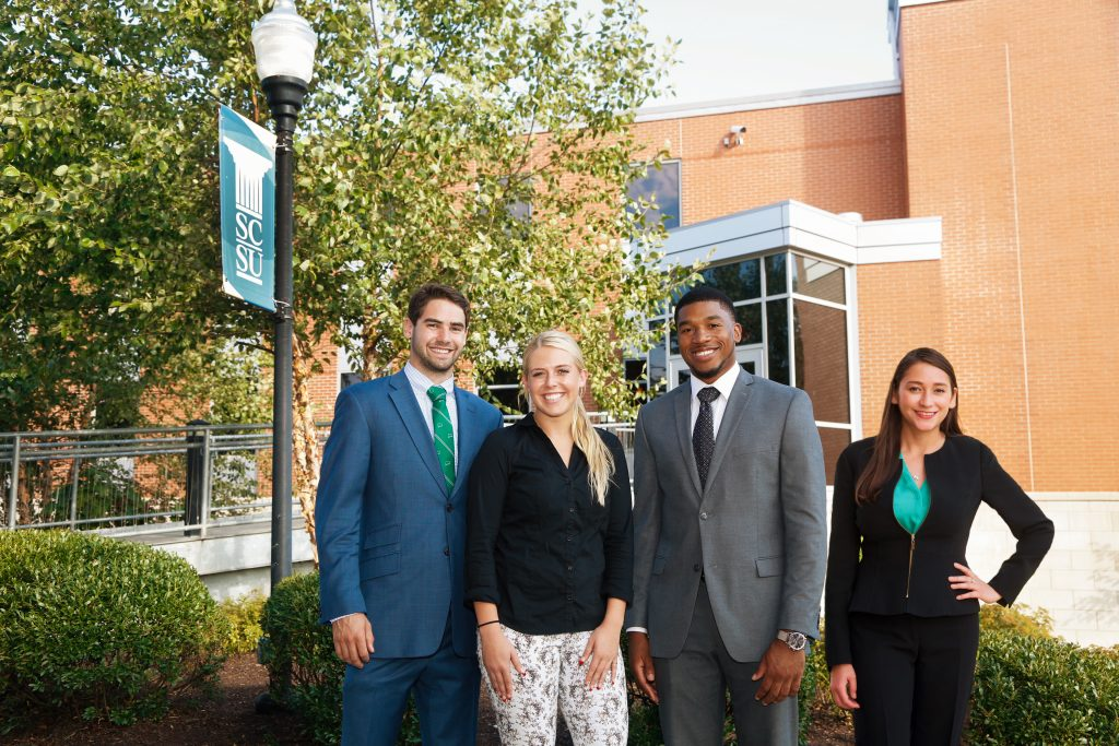 [From left] Students Luke Velez, Brooke Davis and Lyman DePriest interned with Deloitte over the summer, while student Yenny Bayas completed an earlier internship during the busy tax season.