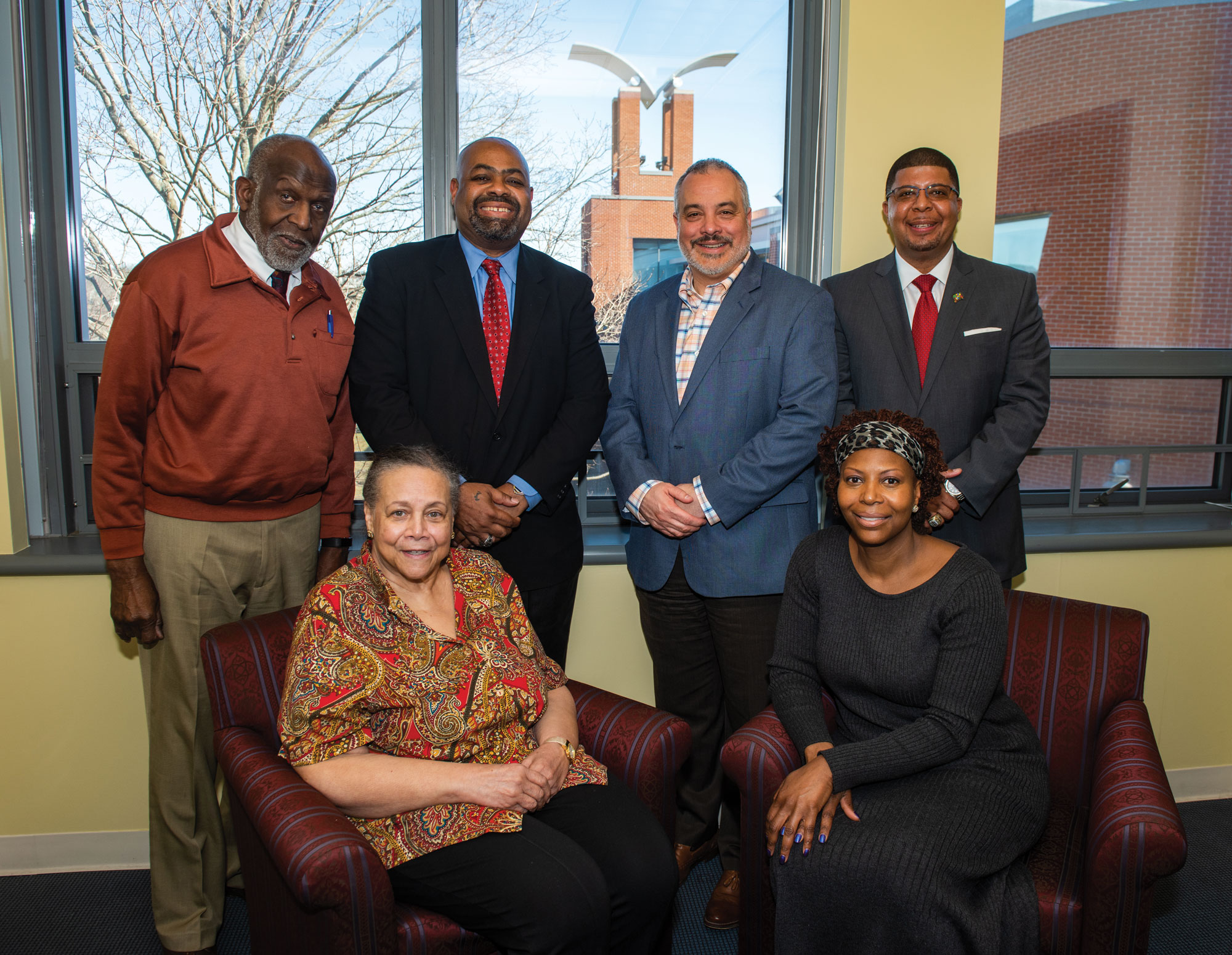 Several alumni of the Black Student Union (BSU) gather to formally establish the Barbara Matthews Endowed Scholarship, named in honor of the longtime adviser of the BSU. [Seated from left] Matthews and Michele Helms, '92, an ESL teacher. [Standing from left] James Barber, '64, M.S. '79, Southern's director of community engagement; Attorney Michael Jefferson, '86; President Joe Bertolino; and Kermit Carolina, '94, M.S. '03, supervisor of youth development and engagement with New Haven Public Schools.