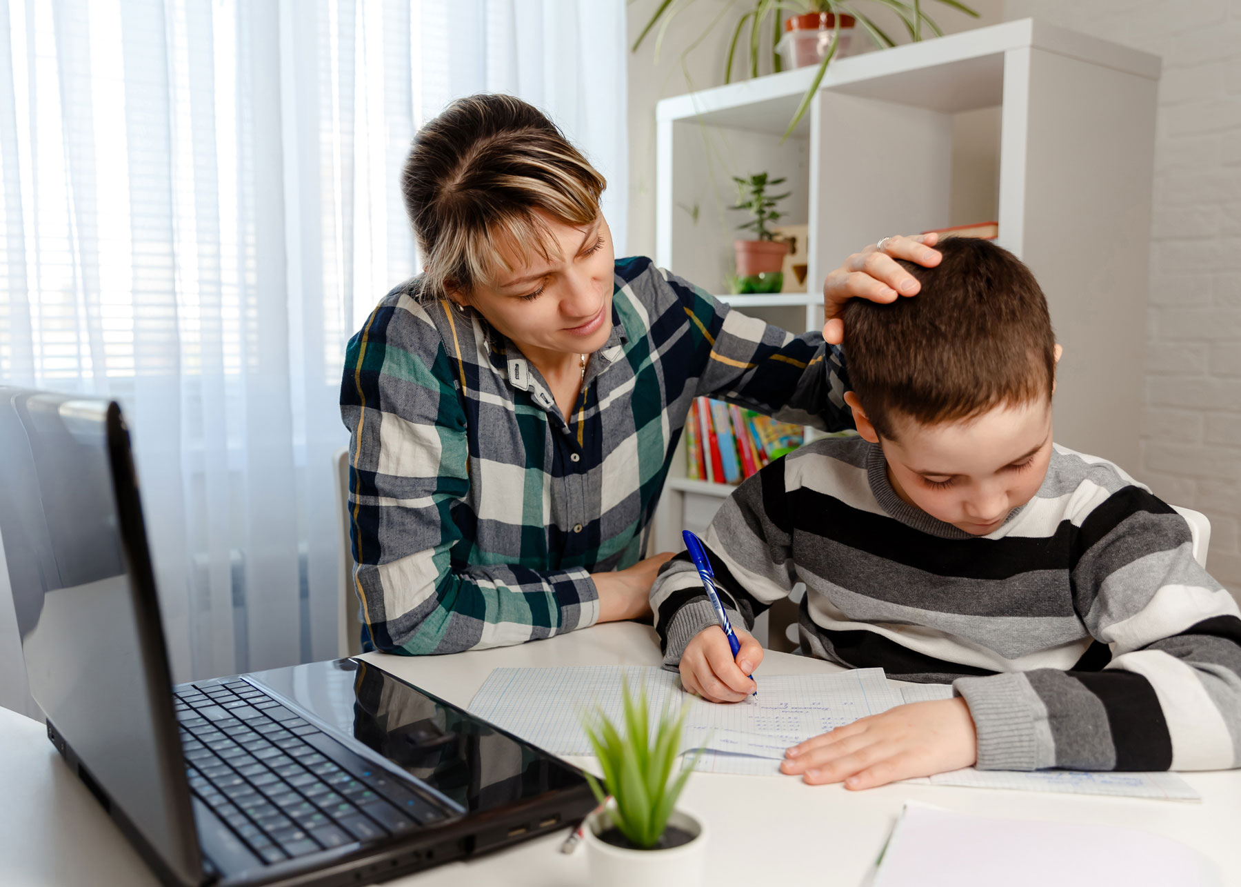Parent and young child studying at home