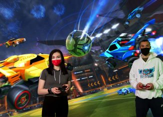 Students Alexandra Cervone and Miles Bagoly play the game Rocket League.