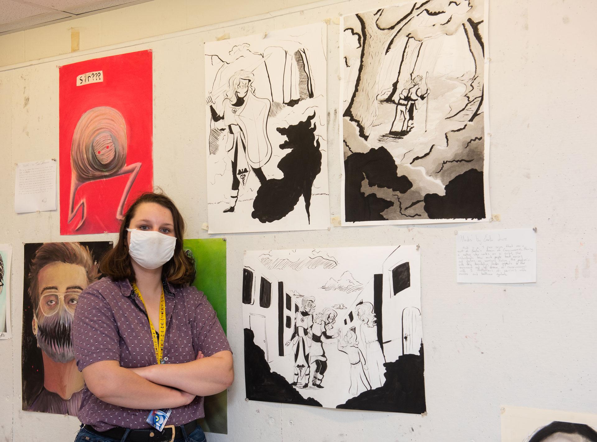 portrait of SCSU student artist Emilia Luz with her work