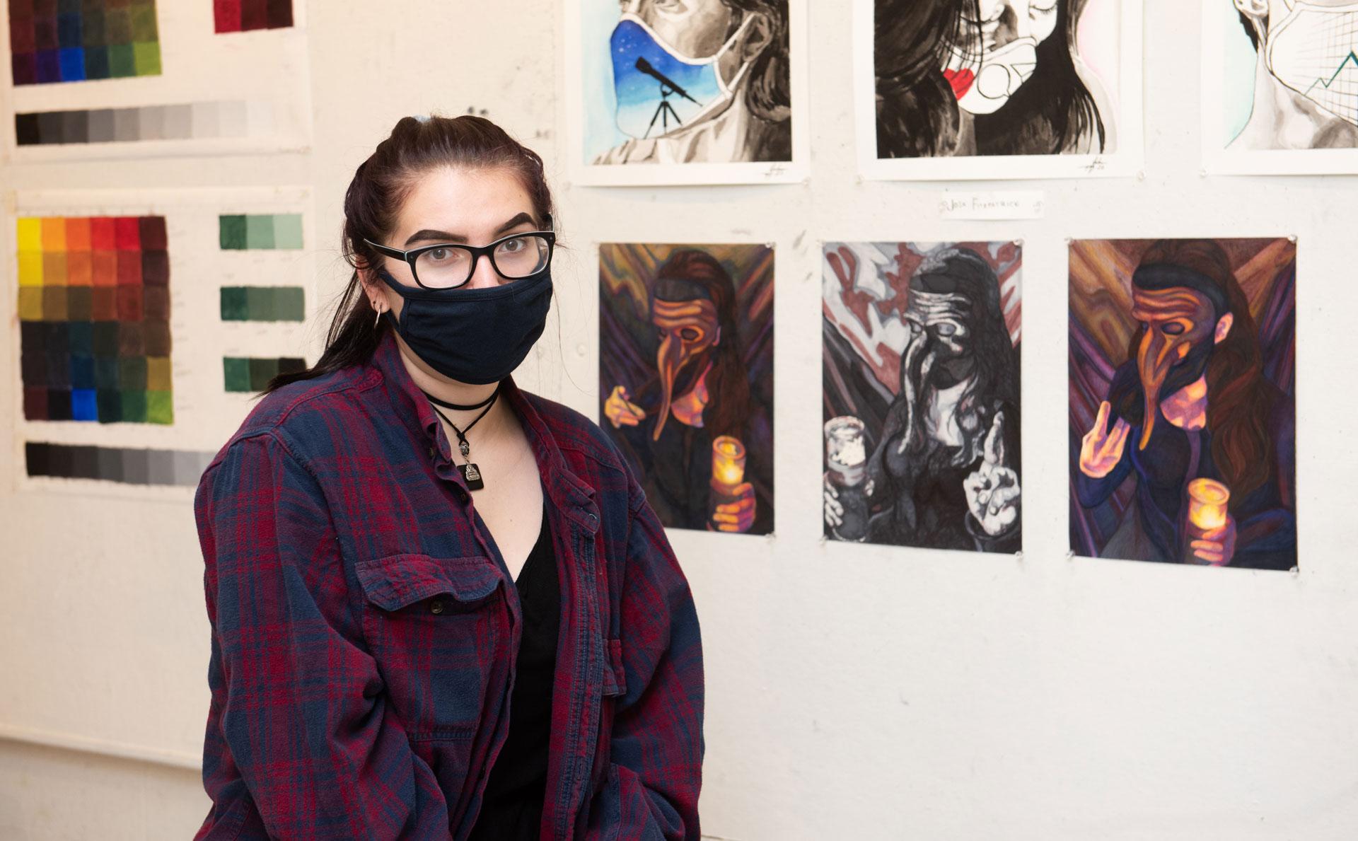 portrait of SCSU student artist Jaime Roy with her work