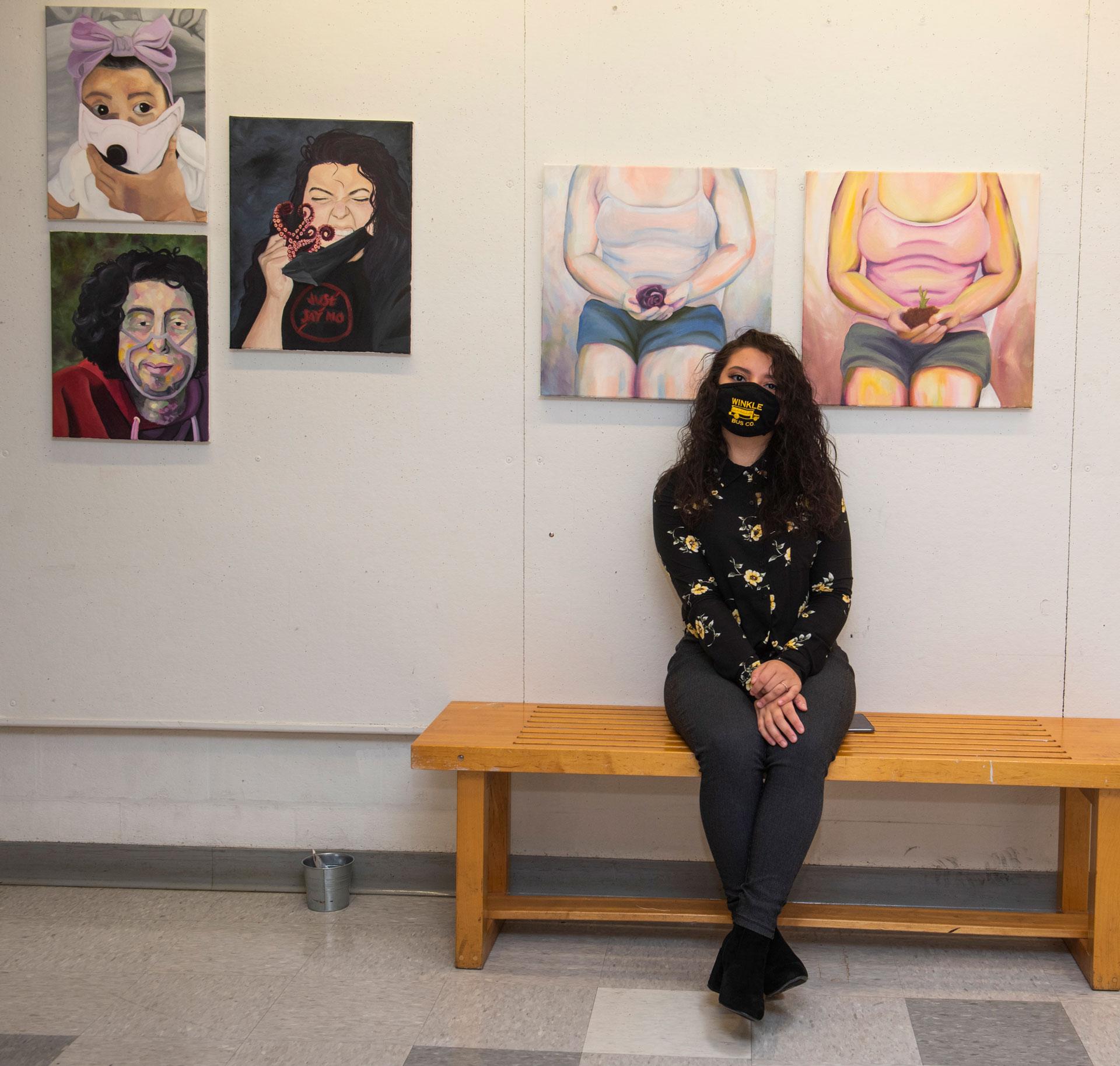 portrait of SCSU student artist Samantha Melendez with her work