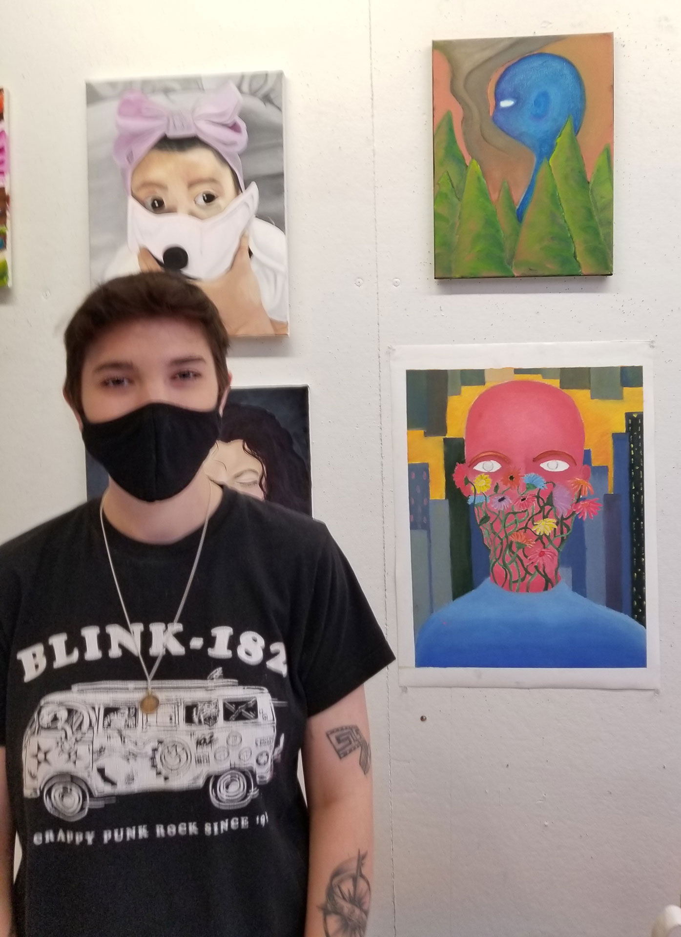 portrait of SCSU student artist Samantha Pansa with her work