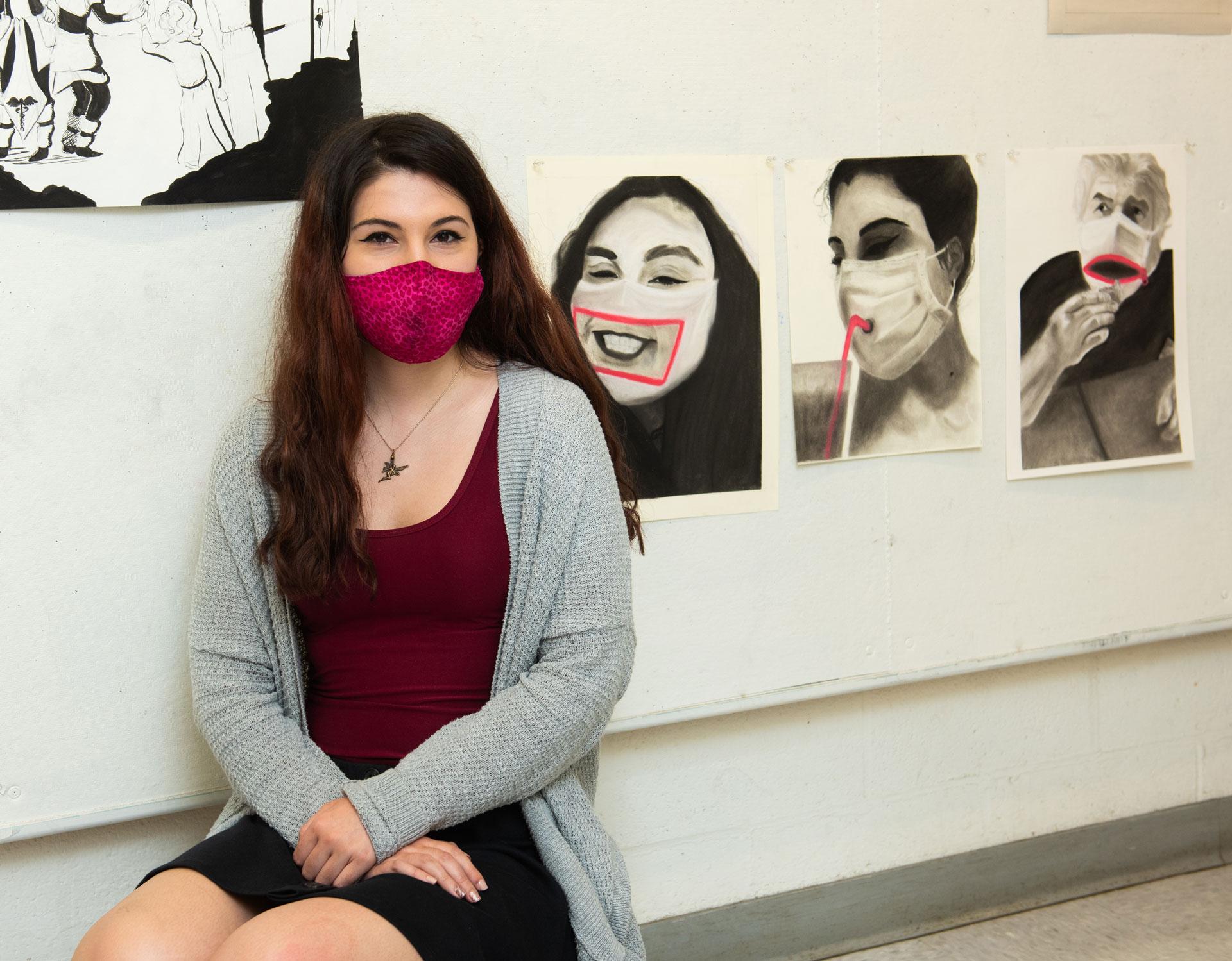 portrait of SCSU student artist Shaina Alexander with her work