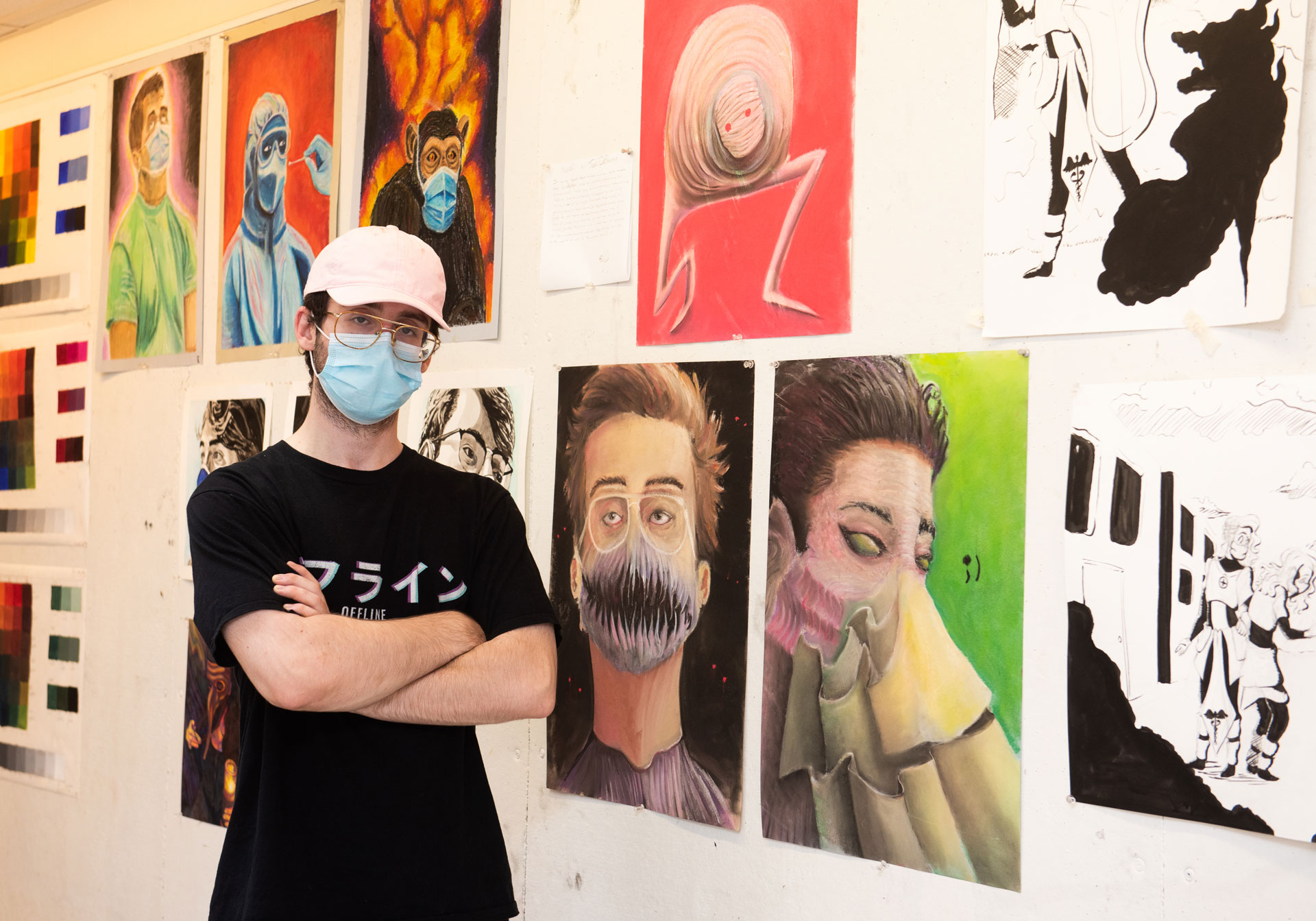 portrait of SCSU student artist Thomas DeFranco with his work
