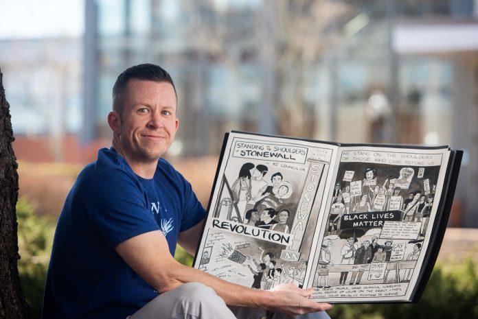 KC Councilor displays his book of comics