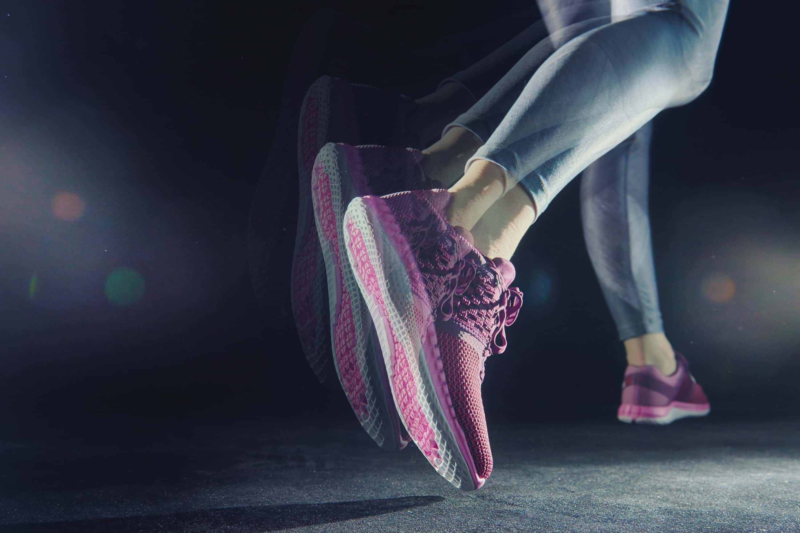 photo of a pair of feet in pink sneakers apparently running