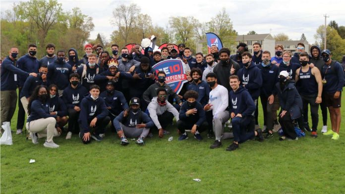 a group photo of the men's track and field team