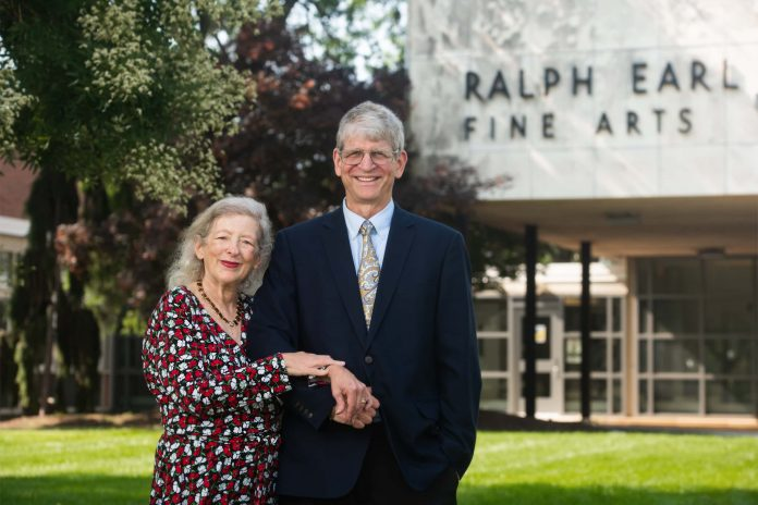 Esther Friesner-Stutzman and Walter Stutzman stand in front of Earl Hall on the SCSU campus