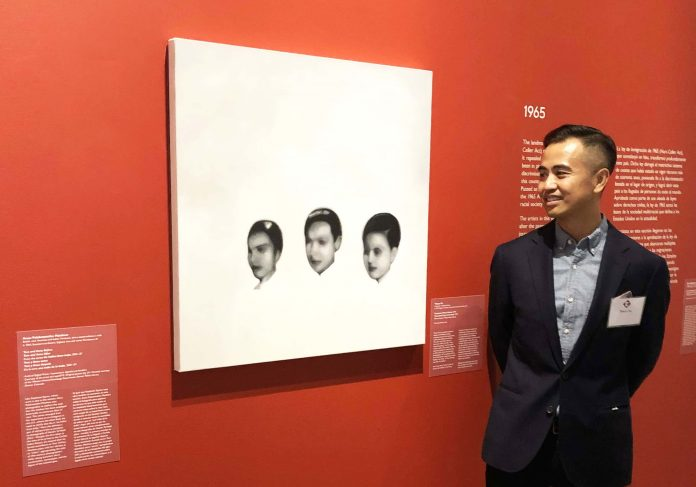 Thuan Vu with one of his paintings